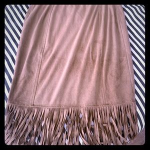 Suede-like knee length fringe skirt.